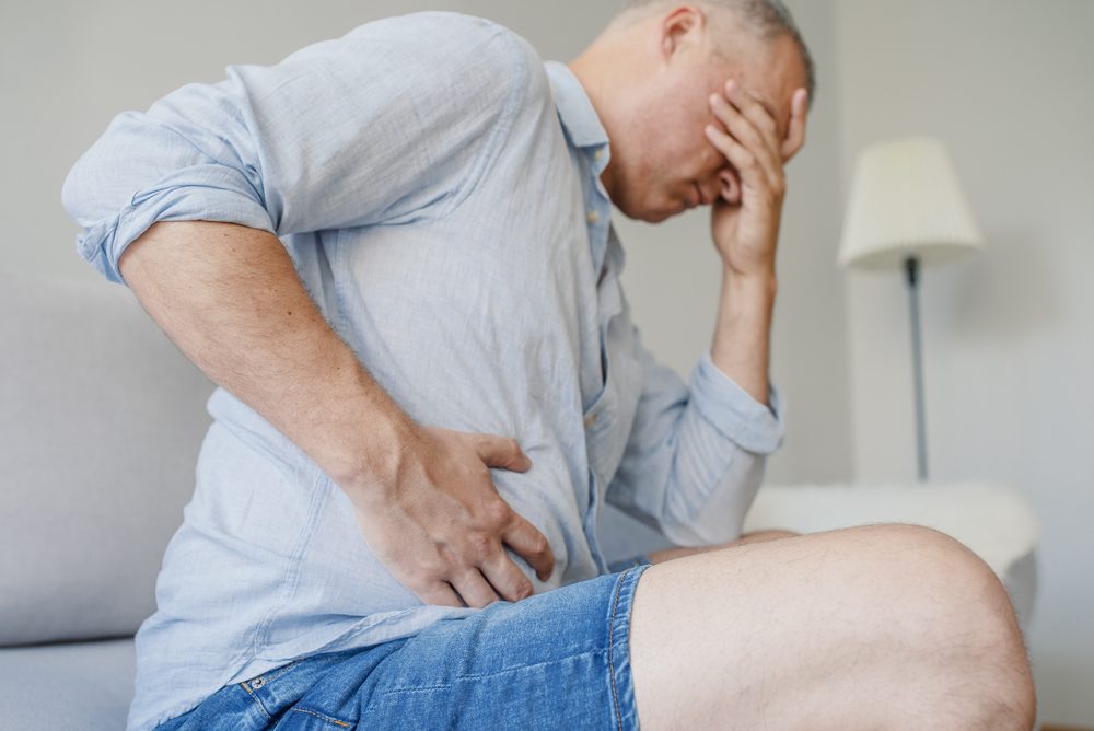 Man suffering from Abdominal Pain and Colitis